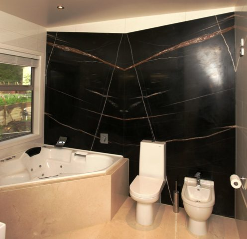 Sahara Noir Book Match On Bathroom Wall Spazio Marble Amp Granite